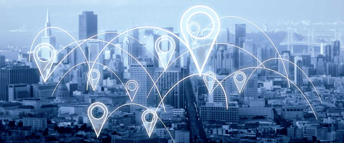 Location Icons Scattered Across City Skyline with Lines Connecting - Digital Marketing Group Geotargeting Blog