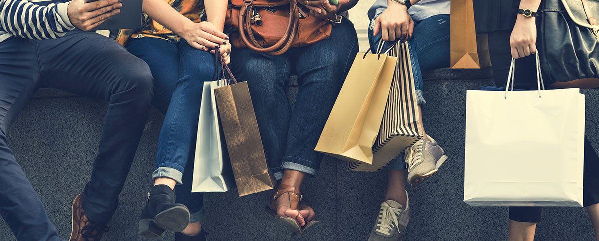 Group of People Sitting Together with Shopping Bags - DMG Blog
