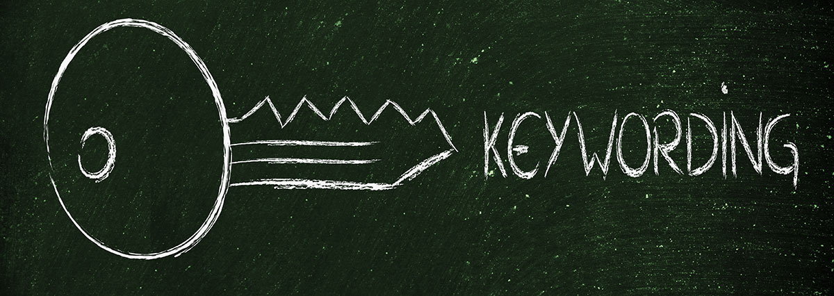 """Key Drawn on Chalkboard with """"Keywording"""" To The Right - SEO Content Blog"""