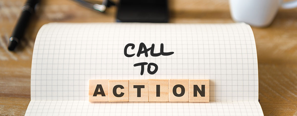 """Notepad open on desk with the words reading """"Call To Action"""" - SEO Strategy Blog"""
